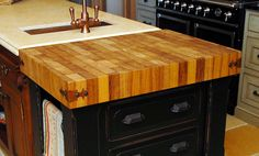 4 inch Iroko Wood Countertop in brown and blond colors with 1/8 inch Roundover edge profile and a Food Grade Oil finish.  http://www.glumber.com/products/design-gallery/