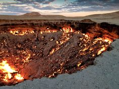 """While Joss Whedon led us to believe that the entrance to hell could be found in Sunnydale, California, he was actually some 7,500 miles off. Located in the middle of the Karakum Desert in Turkmenistan is the """"Door to Hell,"""" a name locals gave to a 230-foot-wide crater that simply won't stop burning. When Soviet scientists began searching for oil back in 1971, they accidentally hit a methane reserve and the drilling platform collapsed, forming the crater and releasing dangerous gas into the…"""