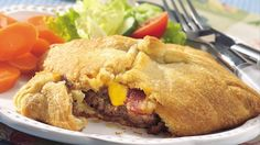 Try this classy upgrade for your next burger; it's baked in refrigerated crescent roll dough in place of the predictable bun. Crescent Roll Dough, Crescent Roll Recipes, Crescent Rolls, Beef Dishes, Food Dishes, Main Dishes, Ranch Burgers, Burger Toppings, Bbq Bacon