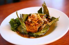 Malibu Beach Sustainable Fish Wrapped in Banana Leaf at Disney's PCH Grill at the Paradise Pier Hotel