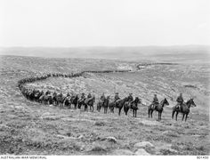 The 1st Australian Light Horse Brigade moving down from Judea to the capture of Jericho. Brigadier General Cox is at the head of the column, with Major A Chisholme DSO (Brigade Major), next to him. Ottoman Empire: Palestine, February 1918 by Frank Hurley