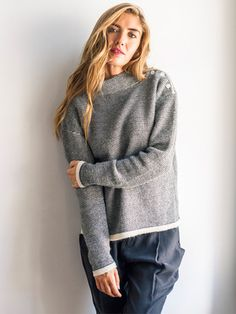 <p>This item is pre-order for delivery end September</p> <p>Alpaca sweater handloom fully fashioned knit mock neck sweater with button closure at left shoulder.</p> <p>100% Alpaca. Made in Peru</p>