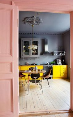From-the-living-room-and-into-the-kitchen-there-is-pink-wall-and-door-andkitchen-with-grey-wall-painted-plus-yellow-color-cabinet.jpg (1000×1608)