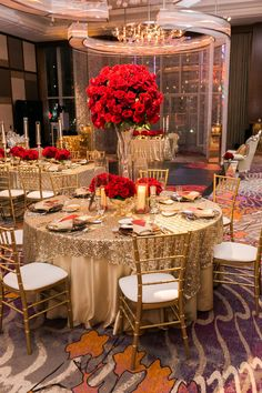 Gold tables topped with tall red rose centerpieces Las Vegas Wedding Planner Andrea Eppolito www andreaeppolitoevents com Photo by J Anne Photography www jannephotography com As seen on The Weddin - Quince Themes, Quince Decorations, Red Wedding Decorations, Quince Ideas, Red Table Decorations, Sweet 16 Decorations, Quinceanera Decorations, Quinceanera Party, Themes For Quinceanera