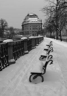 Romantic walk along Vltava river in Prague during winter season.