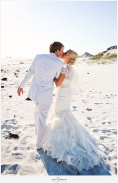 I like seeing  a beach wedding where the bride still went big on the dress. Usually beach weddings end up being too casual for my taste. My beach wedding will still be a very formal affair!