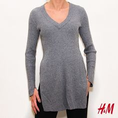Long elegant sweater with side slits This sweater is in like new condition and can be worn for any occasion ! Has slots on the sides and sleeves ! H&M Sweaters