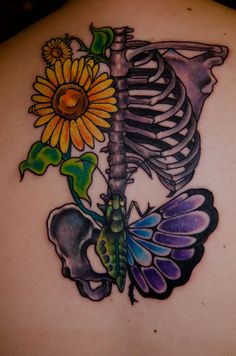 """fuckyeahtattoos:  """" My second tattoo represents a lot of things for me. My dad and I used to grow sunflowers in our backyard. Even though our house was shit, I loved looking out my window and seeing those flowers. He committed suicide when I was..."""