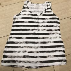 Maternity tank top gray and white stripe Amazingly soft and comfortable tank top... You would never know this was maternity size medium gray and white striped with mini pocket in the front Motherhood Maternity Tops Tank Tops