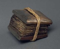 Bark book protected by two wooden covers held together by a braided rattan string. It is a typical way for the Batak people in Sumatra to protect their books. The book contains a medical text (Tambar) of 36 leaves glued together in a libretto form.