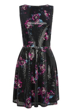 This pretty skater dress pulls out all the stops with it's floral print and sequin detail across the fabric. The piece features a deep v on the reverse and a concealed zip fastening to finish.