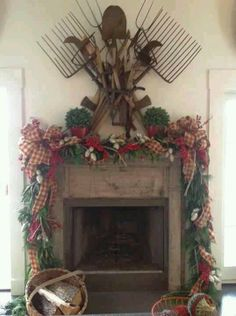 I love all the greens and ribbons on this fireplace mantel.