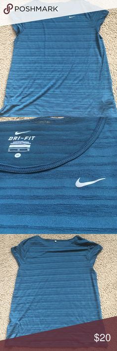 Nike dri-fit teal and navy shirt Nike dri-fit teal and navy shirt. It's semi sheer but in perfect condition. Nike Tops Tees - Short Sleeve