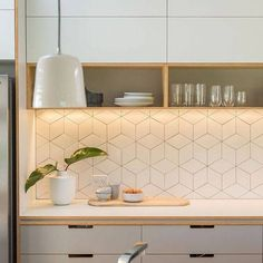 Looking to re-tile your kitchen or bathroom? Try a funky geometric tile! This falling block tile design is on-trend around the world. For more ways to add graphic pattern and punchy prints to your home, go to Domino.