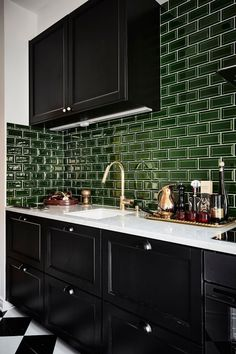 Halloween Style! Yes! Do a deep dark and delicious kitchen! Black glossy cabinets with dark green tile backsplash and white counter!