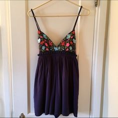 LF Stores Oaxaca Romper With Pom Poms Size 6 Gorgeous navy blue romper with Oaxaca-style embroidery and pom-poms. Spaghetti straps and a low back. Cute but still sexy! Size 8 but has a stretchy waistline so there's some wiggle room to fit a range of sizes which is why I've listed it as a 6 (this will probably fit size 4 to size 8). Model in last photo is size 4 for reference. Worn twice with no signs of wear. Purchased at LF in LA for $160, brand is 'Debbie Debbie' LF Pants Jumpsuits…