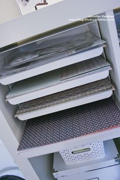 Ikea paper sorters fit into Expedit and can be altered to fit 12x12