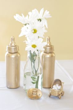 centerpiece of daisys and baby shower decor from the dollar store