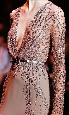 Elie Saab, the detail, the thing I love most about Elie Saab is that i think he makes his clothes look as expensive as they are, they are unique and the detail is incredible...