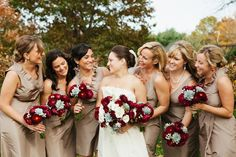 Nice colour combination for a fall wedding: beige dresses with deep red/burgundy flowers.
