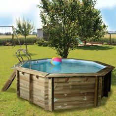 Espectacular piscina desmontable enterrada y con tarima de for Astillas de madera para jardin