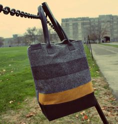 R. Riveter Handbags.  AWESOME company created & run by military spouses.  All the bags are made from recycle military blankets, bags, buckles, etc....   Very COOL!!  LOVE THEM