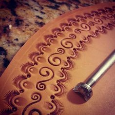Swirl patterns tooled and stamped on leather Leather Stamps, Leather Art, Sewing Leather, Leather Pattern, Custom Leather, Leather Cuffs, Leather Design, Leather Books, Leather Tooling