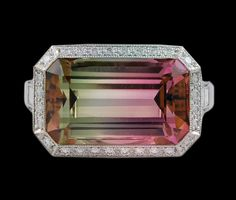 Watermelon tourmaline ring with 7.66 watermelon tourmaline and 0.76 diamonds set in platinum. USA. Modern