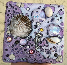 "Pretty mosaic tile, using beach-y materials ("",)"