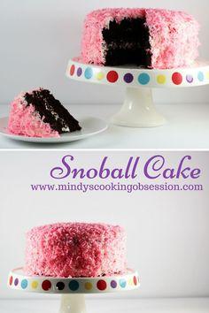 Snoball Cake features a rich chocolate cake, decadent cream filling, vanilla…