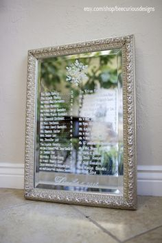 Beautiful silver detailed mirror seating chart with snowflake detail. escort sign display. winter wedding signage. snowflake style.