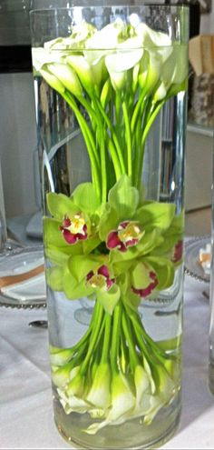 Very cool Calla Lilly and orchid water flower Corporate flowers, corporate flower centerpiece, add pic source on comment and we will update it. http://www.myfloweraffair.com can create this beautiful flower look.