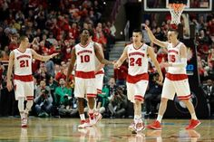 Wisconsin's Josh Gasser (21), Nigel Hayes (10), Josh Gasser (21), Sam Dekker (15)  Frank Kaminsky (44) celebrate as they walk off the court in the second half of an NCAA college basketball game against Purdue in the semifinals of the Big Ten Conference tournament in Chicago, Saturday, March 14, 2015. Wisconsin defeated Purdue 71-51. (AP Photo/Nam Y. Huh)