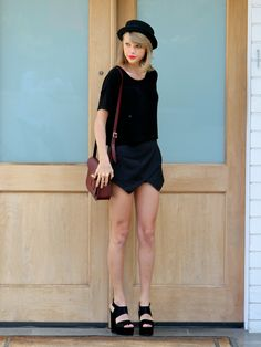Taylor Swift rocking our Twist Lock satchel in oxblood out in LA