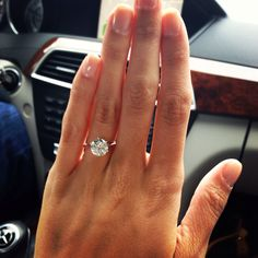 1.5 karat or above round solitaire with plain band. nothing else around it :)