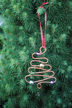 Christmas ornament. Made these years ago- S hooks with beads for present tags- snowflakes all from copper wiring/ still use them in kitchen window to hang chandelier crystals and bobs of all sorts