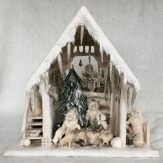 Antique beautiful German winter wonderland Snow House filled with antique bisque dolls and other accessories