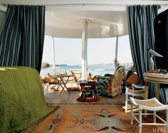 The master cabin, with beaded chairs from Mali and Thebes stools found at Hani Loft, Cairo.