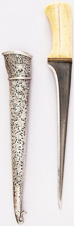 Indian (Mahratta) pesh kabz, 18th to 19th century, wootz steel blade, silver, wood, ivory (elephant), gold,  L. with sheath 17 1/4 in. (43.8 cm); L. without sheath 16 in. (40.6 cm); L. of blade 11 3/4 in. (29.8 cm); W. 2 1/8 in. (5.4 cm); Wt. 11.1 oz. (314.7 g); Wt. of sheath 5.6 oz. (158.8 g), Met Museum, Bequest of George C. Stone, 1935.