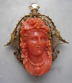 """Material : Sardinia Coral, 14k gold tested. Size: Brooch 2 1/2""""by  2 2/8"""" - Earrings  1"""" by 4/8"""".   Date and Origin: Circa 1860 Italy."""