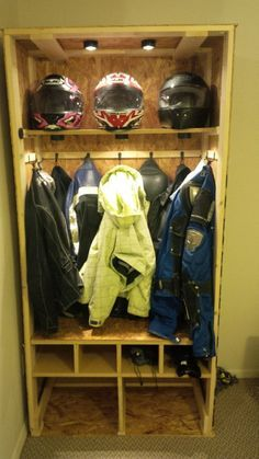 motorcycle gear garage storage - This Is a little fancy with the lights.