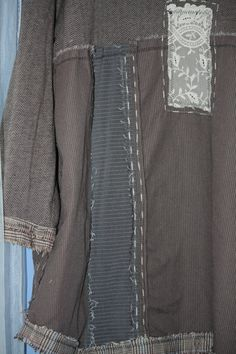 Size: oversized    -This is a beauty!  -The whole thing is a lovely grey/brown shade material.  -It has antique lace in front and hand stitching. -Raw