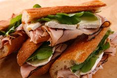This ham and Camembert cheese sandwich is served on a crusty French baguette and dressed with a little fig jam.