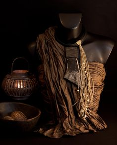 Beautifully polished buffalo horn and ebony,linen string, bone beads
