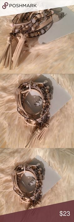 CLOSET CLOSING ‼️ reduced from $24⚜This is stunning!! This bracelet is triple twist on bracelet with natural stones and tassels. This is definitely a must have go from summer to winter with this beauty. Boutique Jewelry Bracelets