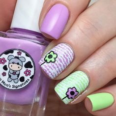 I just love the combo of bright purple and green, and these two from @moomoosignatures worked perfectly!  @uberchicbeauty stamping plate 9-02 came out to play, and I used this wiggly line image (?) stamped in white, and then reverse stamped the cute flowers, in the corresponding colours, from the same plate.  I left this without topcoat, as I really like the texture effect!  @uberchicbeauty plates and @moomoosignatures Ocean Song and Bells of Ireland, are all available from…