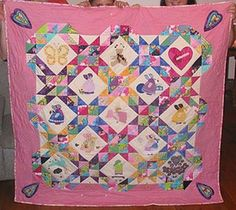 """""""Dancing in my Heart""""........a memory quilt made by Janet Cumming & I for the parents of our disabled children's friend, Lissy, when she died, aged 14. Each sunbonnet sue block represented Lissy's life, with angels wings for """"Angelman's Syndrome"""", music & therapy, with her dog, with a walking frame, etc."""