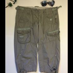 Capri modern fit taupe color Lots of pockets and zippers. Lower rise with extra buckles on each side to tighten the waist. Draw sting at bottom of each leg. Gently used. Cute pants. refuge Pants