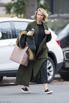 Cover (up) girl: Lara Bingle was spotted heading out on a solo shopping trip in Paris over...