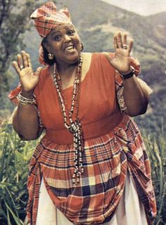 A respected and highly mourned entertainer across the West Indies. Miss Lou hailing from Jamaica wearing the traditional plaid print. She is one of the greatest satirist of yesteryear. Jamaican People, Jamaican Women, Jamaican Art, Jamaican Music, Jamaican Quotes, Jamaican Recipes, Bolivia, Uganda, Jamaica National